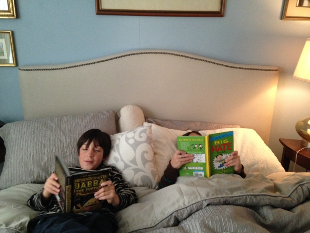 Pleasure reading in a luxe grandparent bed.