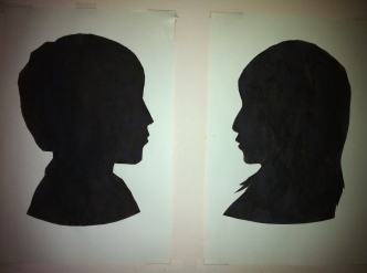The silhouettes the boys made of each other when we studied colonial times.